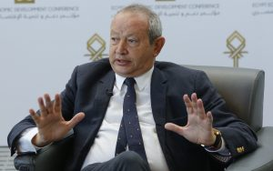 Egyptian billionaire Naguib Sawiris speaks during an interview with Reuters in Sharm el-Sheikh, in the South Sinai governorate, south of Cairo, March 15, 2015. Sawiris said he was ready to invest $500 million in Egypt and was diversifying his telecoms business into infrastructure, energy and transportation, sectors which need major funds in the country. REUTERS/Amr Abdallah Dalsh  (EGYPT - Tags: BUSINESS POLITICS) - RTR4TF94